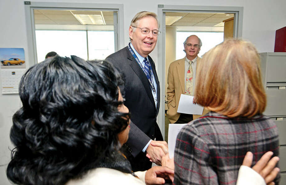 Hour photo / Erik Trautmann Mayor Elect David Martin greets Sandra Siegartel in Community Development as he tours the Stamford Government Center to meet employees.