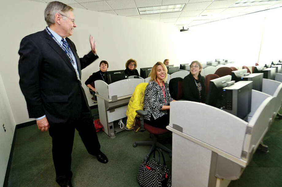 Hour photo / Erik Trautmann Mayor Elect David Martin greets educators in the William Stove Training Room during his tour of the Stamford Government Center to meet employees.