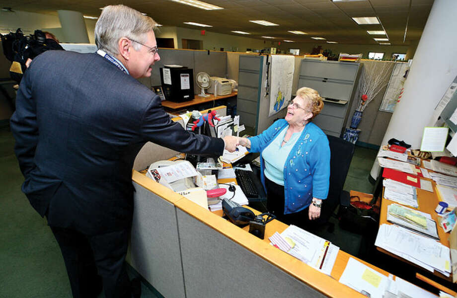 Hour photo / Erik Trautmann Mayor Elect David Martin greets Customer Service Specialist Terri Infonti as he tours the Stamford Government Center to meet employees.