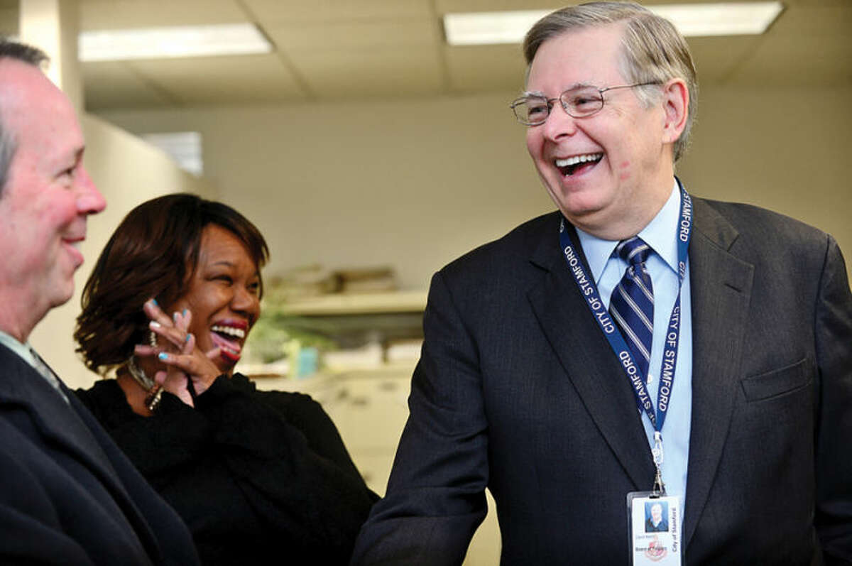 Hour photo / Erik Trautmann Mayor Elect David Martin greets Bob Murray, Labor Relation Specialist and Angie Murphy Office Support Specialist as he tours the Stamford Government Center to meet employees.