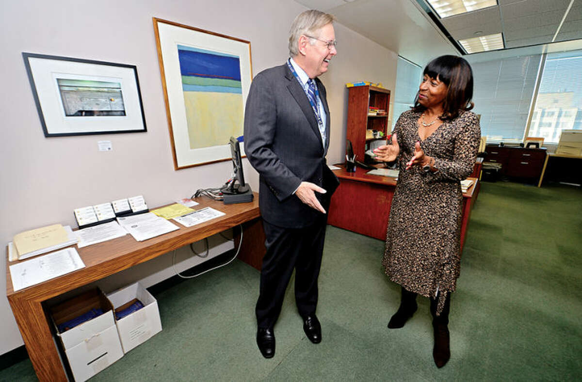 Hour photo / Erik Trautmann Mayor Elect David Martin greets Gloria Depina, Constituent Service Representative for Congressman Himes as he tours the Stamford Government Center to meet employees.