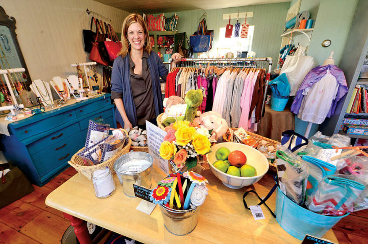 Hour photo / Erik Trautmann Megan Abrahamsen, Blue Star Bazaar owneropens her boutique at 146 Danbury Road, Wilton, CT in the Old Hurlbutt Street Post Office at Lambert Corner. The shop features apparel for women and children, accessories including jewelry, handbags, and scarves as well as heirloom quality toys.
