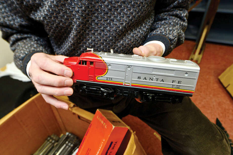 Hour photo / Erik Trautmann Wilton Historical Society prepares for its first annual Holiday Trunk Show and Great Trains Holiday Exhibit. The train exhibit will feature donated antique model train sets in a variety of gauges.