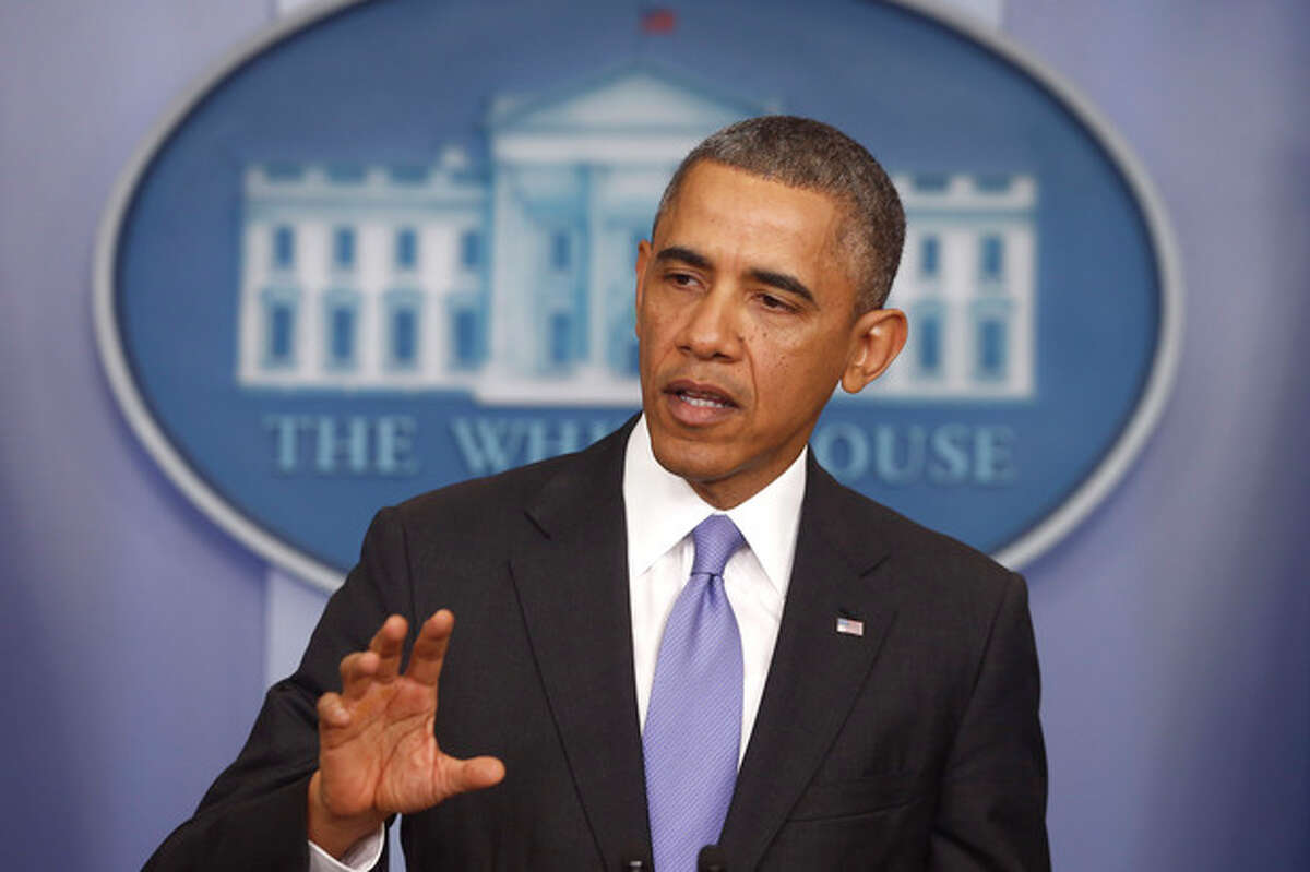 President Barack Obama speaks about his signature health care law, Thursday, Nov. 14, 2013, in the Brady Press Briefing Room of the White House in Washington. Bowing to pressure, the president intends to permit continued sale of individual insurance plans that have been canceled because they failed to meet coverage standards under the health care law, officials said Thursday. (AP Photo/Charles Dharapak)