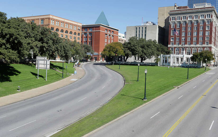The former Texas School Book Depository building, left, now known as the Sixth Floor Museum overlooks Dealey Plaza in Dallas, Tuesday, Nov. 12, 2013, where Lee Harvery Oswald fired from the building killing President John F. Kennedy on Nov. 22, 1963. (AP Photo/LM Otero) / AP