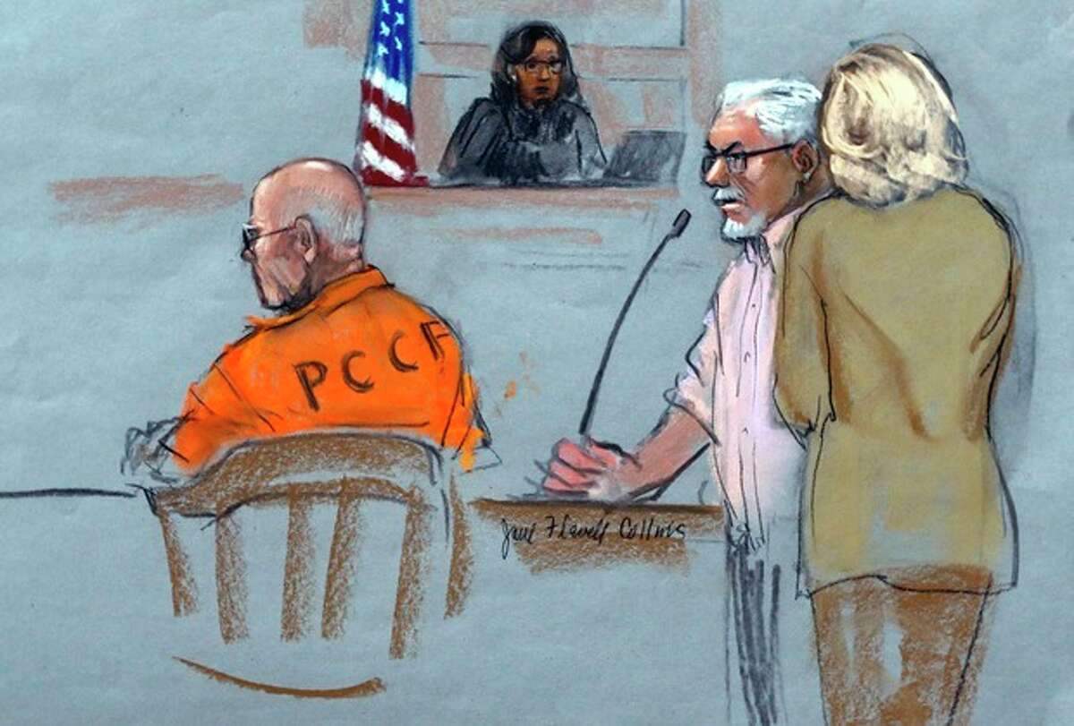 In this courtroom sketch, Steven Davis, second right, brother of slain Debra Davis, is comforted by his wife, right, as he testifies at the sentencing hearing for James
