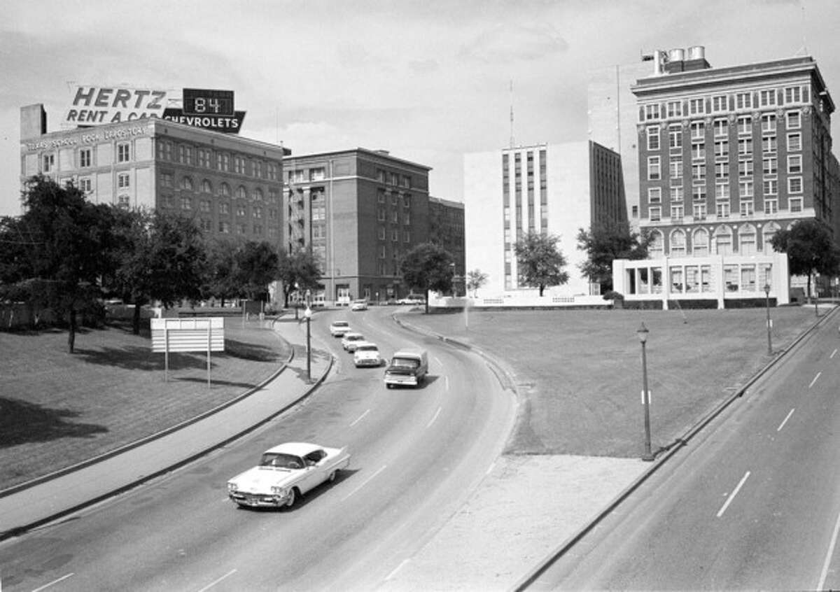 AP Photo/File FILE - This May 22, 1964 photo shows Dealey Plaza where U.S. President John F. Kennedy traveled down when shots claimed his life. The building at left is the Texas School Book Depository Building where Lee Harvery Oswald was determined to have fired the shots.