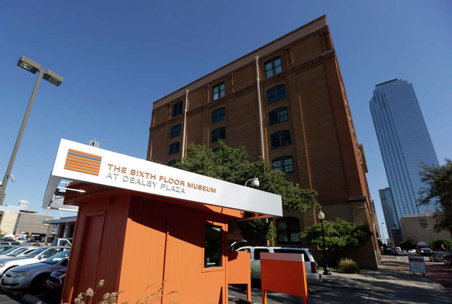 The former Texas School Book Depository, now the Sixth Floor Museum, overlooks Dealey Plaza in Dallas, Tuesday, Nov. 12, 2013. The depository was the site where Lee Harvery Oswald fired a gun, killing President John F. Kennedy on Nov. 22, 1963. (AP Photo/LM Otero) / AP