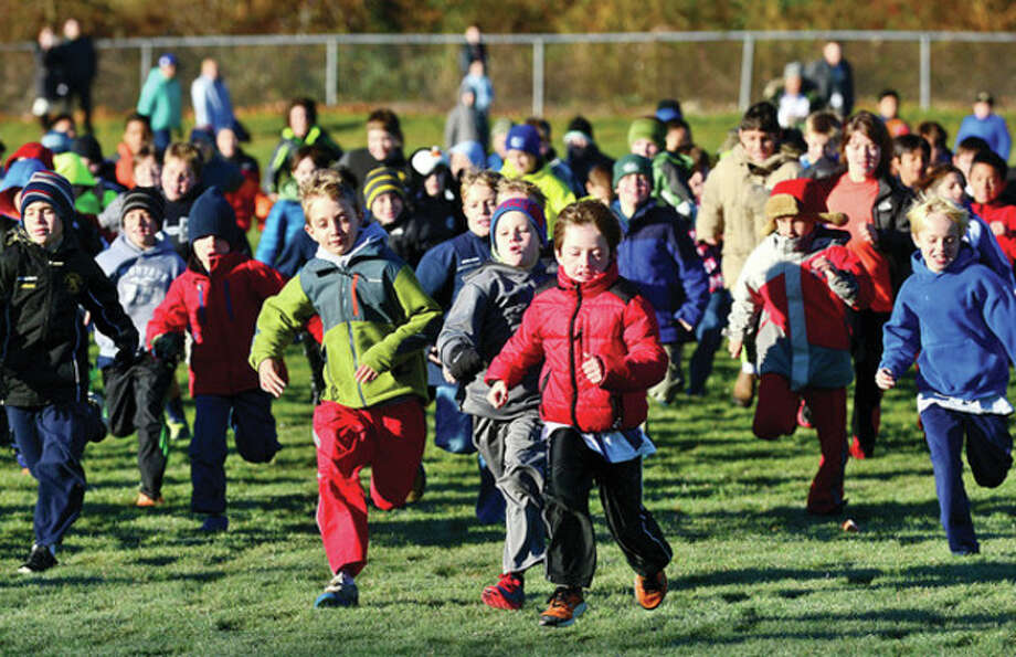 Hour photo / Erik Trautmann Cider Mill Elementary School 3rd graders participate in the school's annual Turkey Trot run Thursday to raise money for Wilton Social Services. / (C)2013, The Hour Newspapers, all rights reserved