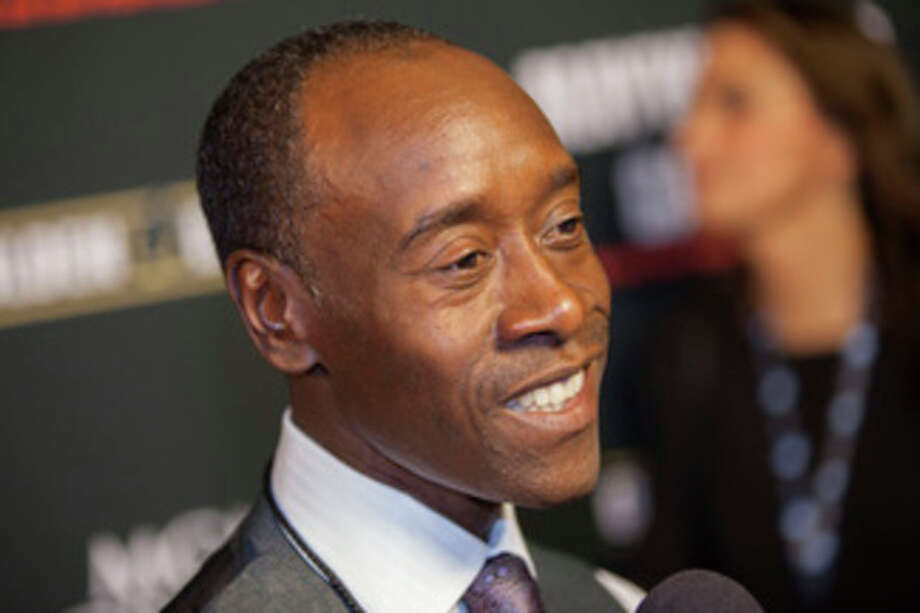 "FILE - In a Saturday, Sept. 14, 2013 file photo, Don Cheadle arrives at the VIP Pre-Fight Party for the One: Mayweather vs. Canelo Fight at the MGM Grand Garden Arena in Las Vegas. Don Cheadle will play Miles Davis in a biopic the actor has long planned on the innovative jazz pioneer. BiFrost Pictures told The Associated Press on Wednesday, Nov. 13, 2013 that it will finance and produce ""Kill the Trumpet Player,"" with Cheadle also making his directorial debut. Production is finally set to begin in June.(Photo by Eric Jamison/Invision/AP, File) / Invision"