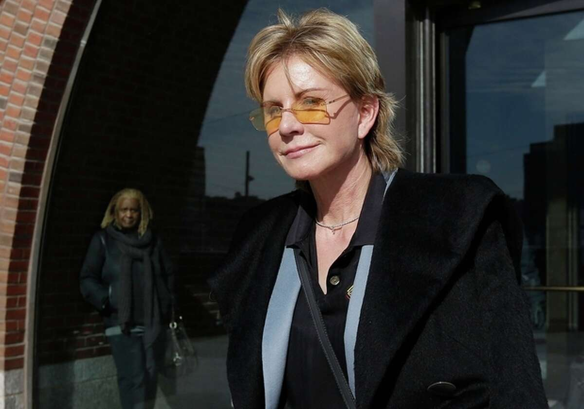 AP Photo/Steven Senne, File In a Feb. 7, file photo, author Patricia Cornwell leaves federal court in Boston after she took the stand in her lawsuit against her former financial management company. Cornwell's 21st Scarpetta novel,
