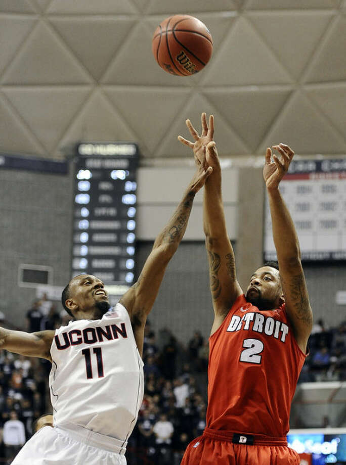 Detroit's Juwan Howard, Jr. shoots over Connecticut's Ryan Boatright during the first half of an NCAA college basketball game Thursday, Nov. 14, 2013, in Storrs, Conn. (AP Photo/Jessica Hill)