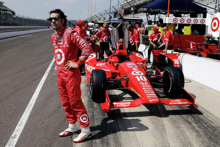 FILE - In this May 19, 2013, file photo, Dario Franchitti, of Scotland, waits next to his car during a break in a practice session on the second day of qualifications for the Indianapolis 500 auto race at the Indianapolis Motor Speedway in Indianapolis. The three-time Indianapolis 500 winner said Thursday, Nov. 14, 2013, that doctors have told him he can no longer race because of injuries sustained in an IndyCar crash last month. He fractured his spine, broke his right ankle and suffered a concussion in the Oct. 6 crash at Houston. (AP Photo/Tom Strattman, File) / FR29600 AP