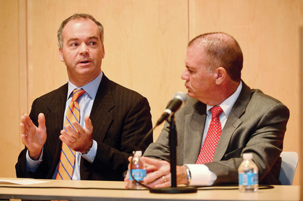 Hour photo / Erik Trautmann Employee Benefits Advisor with Health Consultants Group George Watts and Beacon Physician Placement Services owner John Lavin participate in an informational panel discussion on the Affordable Care Act hosted by State Rep. Gail Lavielle and State Sen. Toni Boucher at the Wilton Library. The forum included expert panelists who explained and answered questions about the implementation of the new Health care Exchange which took effect on Oct. 1.