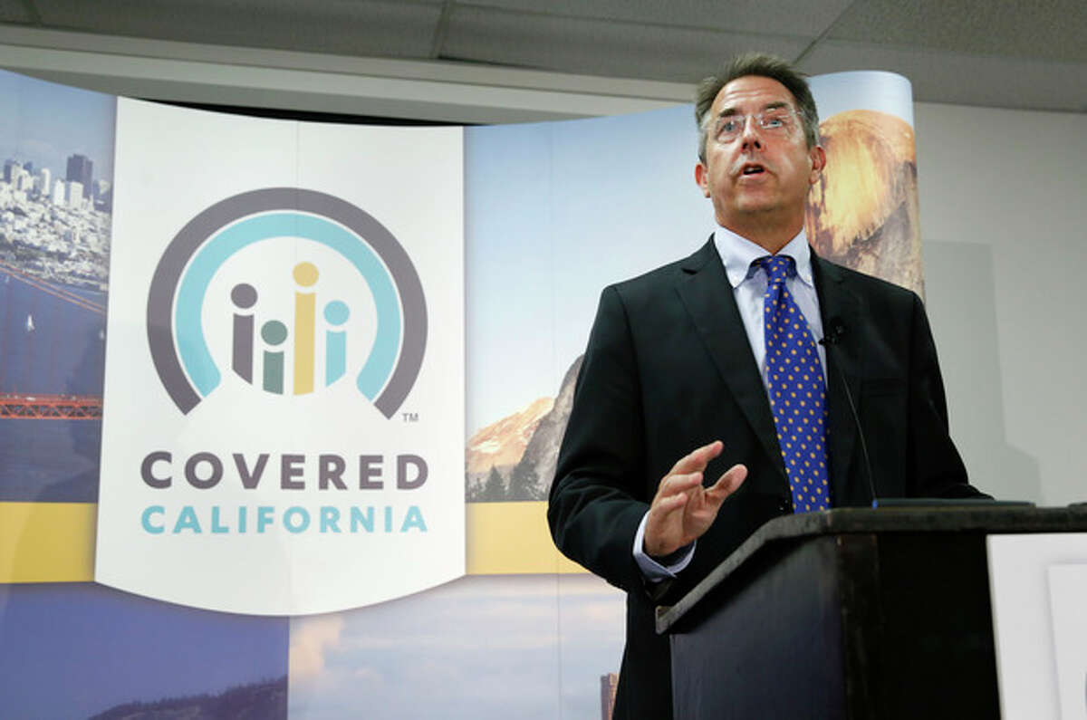 In this photo taken Wednesday, Nov. 13, 2013, Peter Lee, executive director of Covered California, the state's health insurance exchange, announced that nearly 35,000 people signed up for health insurance during the first month of open enrollment, from Oct. 1 through Nov. 2, during a news conference in Sacramento, Calif. The lackluster showing for President Barack Obama's health care overhaul could foreshadow trouble for the embattled program. The plan relies on younger, healthier Americans, who are in less need of health care, to sign-up to cover the costs of expanding coverage to those with serious problems. Lee described October enrollees as