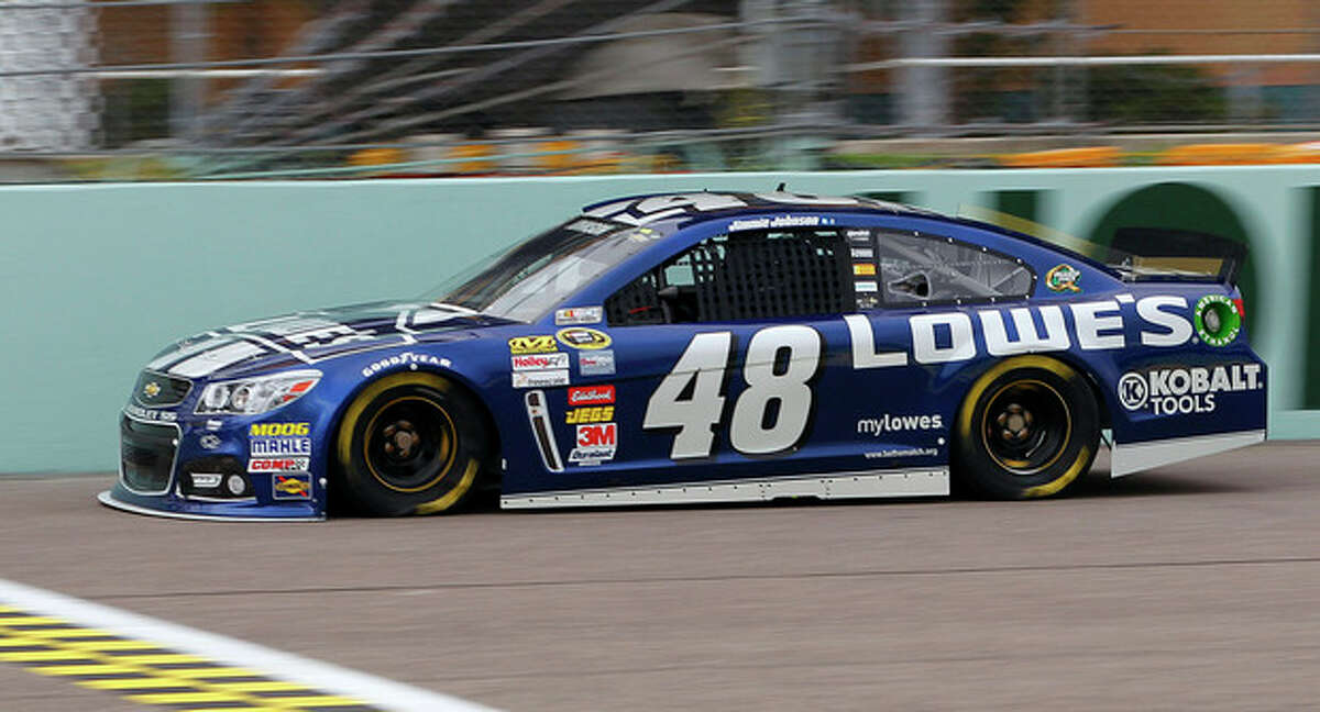 Jimmie Johnson drives a practice lap during practice for Sunday's NASCAR Sprint Cup series auto race Friday, Nov. 15, 2013, at Homestead-Miami Speedway in Homestead, Fla. (AP Photo/Terry Renna)