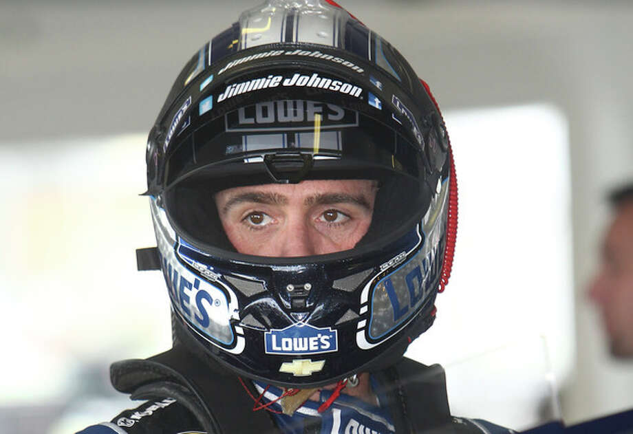 Driver Jimmie Johnson prepares for practice for Sunday's NASCAR Sprint Cup series auto race Friday, Nov. 15, 2013, at Homestead-Miami Speedway in Homestead, Fla.(AP Photo/David Graham) / FR46424 AP