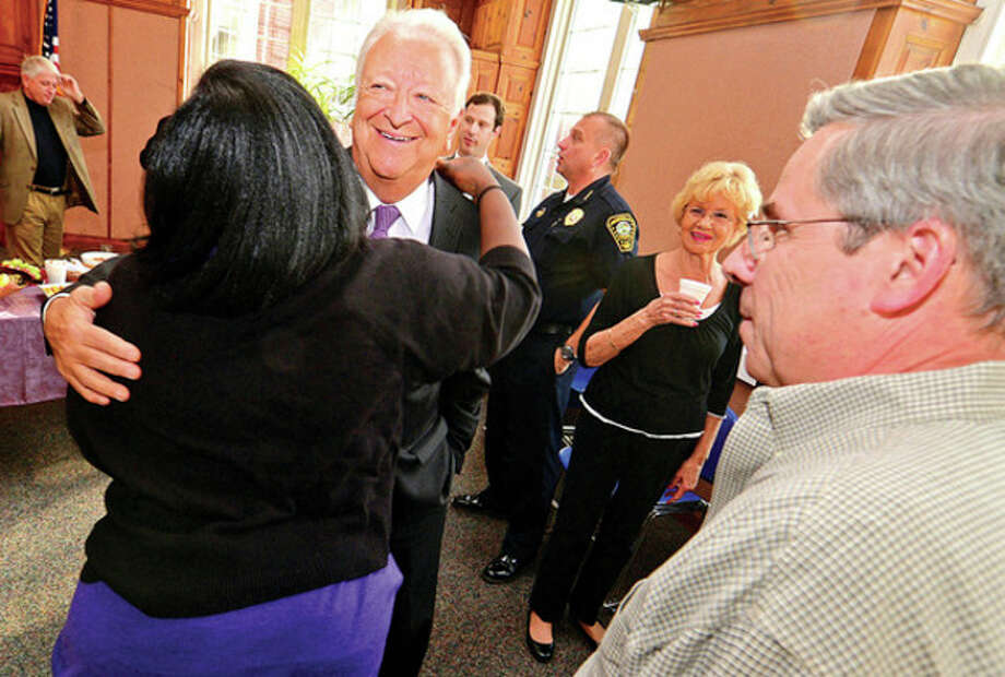 Hour photo / Erik Trautmann City Hall employees including Yvette Williams say goodbye to Mayor Richard A. Moccia during afternoon luncheon in Comunity Room of Norwalk City Hall on Friday / (C)2013, The Hour Newspapers, all rights reserved