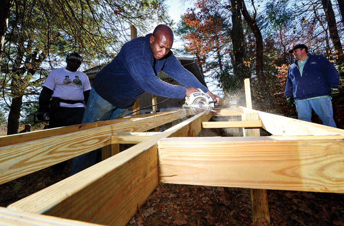 Hour photo / Erik Trautmann Bobby Orr of Boot Camp Farms, a veteran minded company, the Russell Phillips company and donations from PC Metals, help erect an ADA compliant handicap ramp at the home of Norwalk resident Michael Angione, a WW2 Veteran of Norwalk, Saturday.