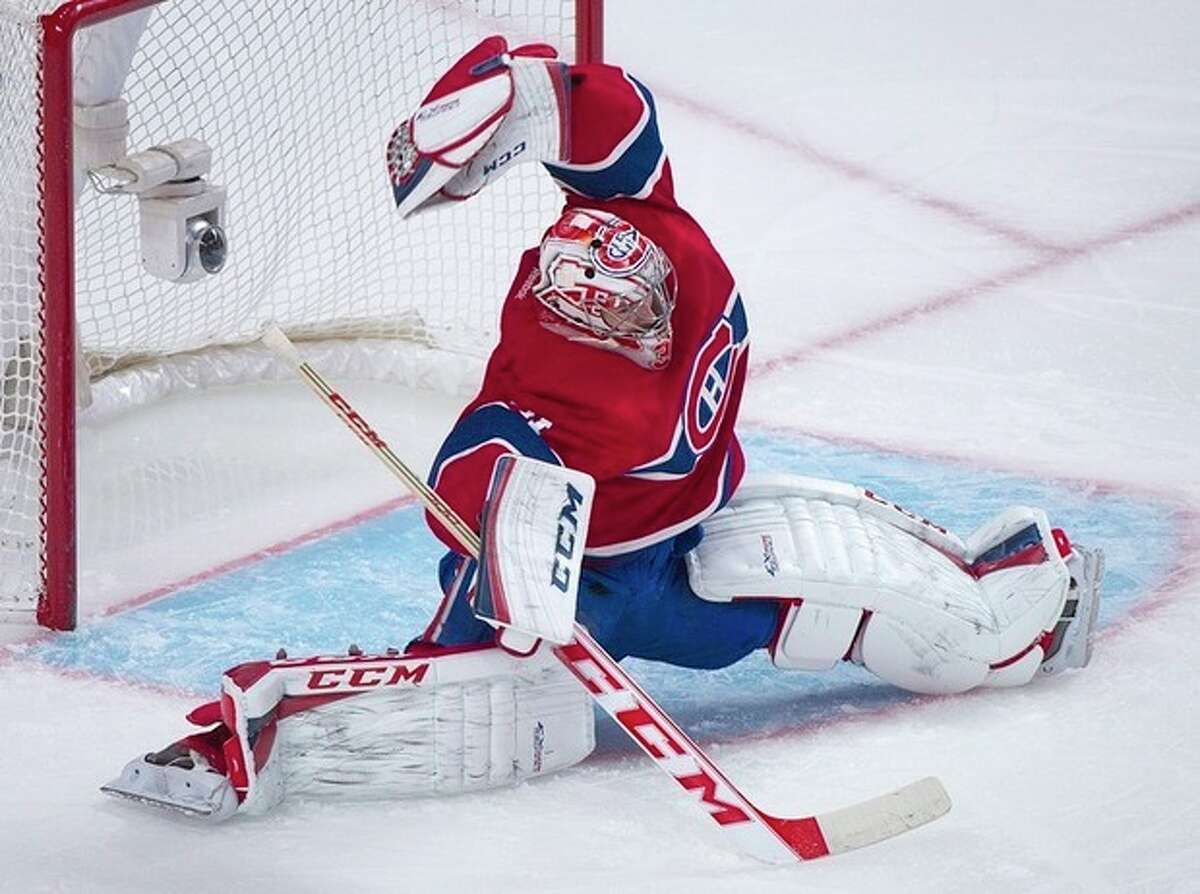 Montreal Canadiens goaltender Carey Price makes a save against the New York Rangers during the second period of an NHL hockey game Saturday, Nov. 16, 2013, in Montreal. (AP Photo/The Canadian Press, Graham Hughes)