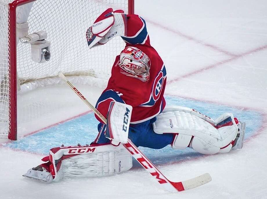 Montreal Canadiens goaltender Carey Price makes a save against the New York Rangers during the second period of an NHL hockey game Saturday, Nov. 16, 2013, in Montreal. (AP Photo/The Canadian Press, Graham Hughes) / The Canadian Press