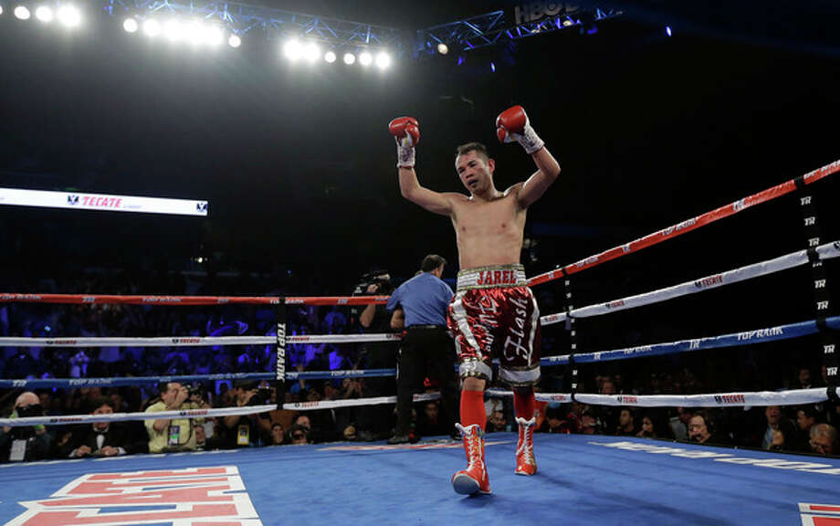 Nonito Donaire celebrates his win over Vic Darchinyan during round 9 of their featherweight rematch, Saturday, Nov. 9, 2013, in Corpus Christi, Texas. (AP Photo/Eric Gay) / AP