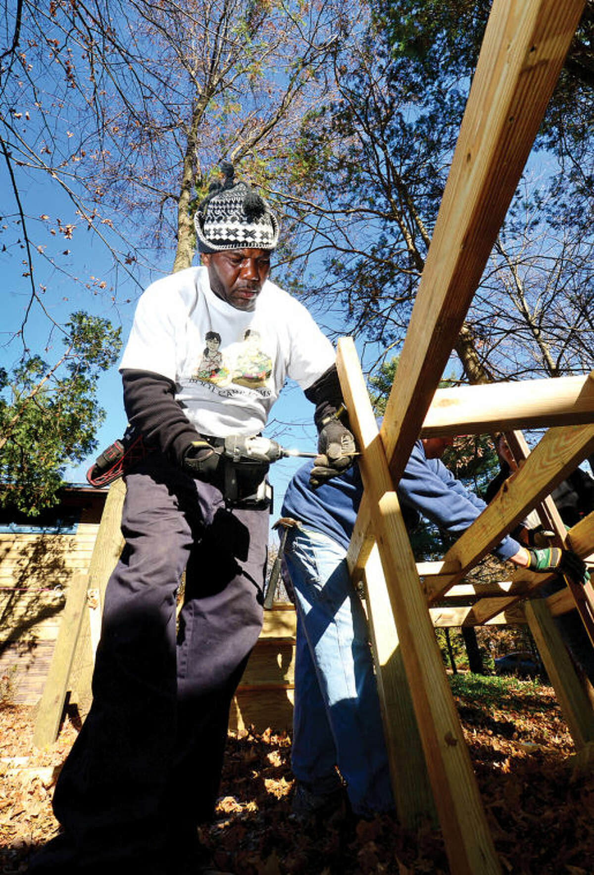 Hour photo / Erik Trautmann BB Williams of Boot Camp Farms, a veteran minded company, the Russell Phillips company and donations from PC Metals, help erect an ADA compliant handicap ramp at the home of Norwalk resident Michael Angione, a WW2 Veteran of Norwalk, Saturday.