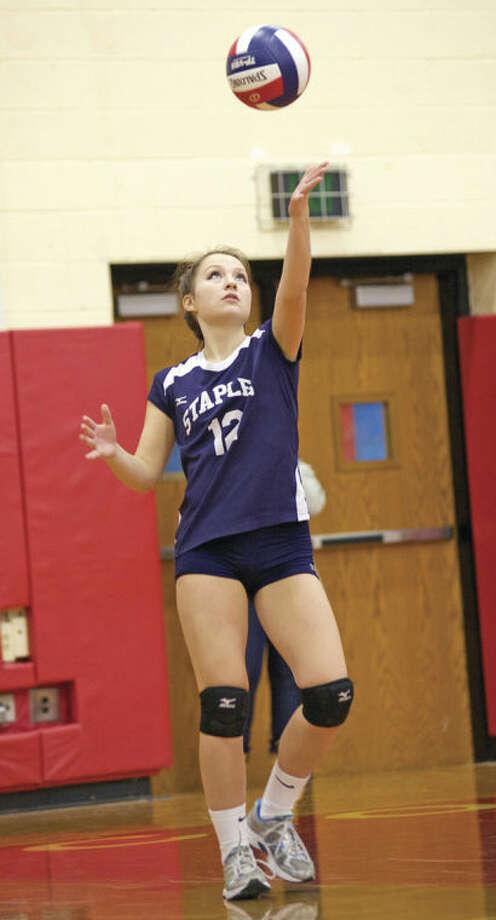Hour Photo / Danielle CallowayStaples' Dayna Gelman looks to serve the ball during the CIAC Class LL State Championship game against Cheshire at Berlin High School Saturday evening.