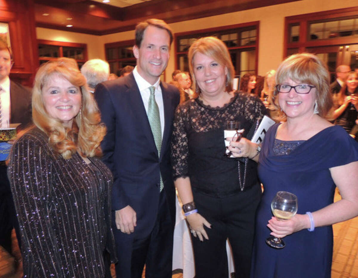 Contributed photo At left, Auctioneer June Delair with Congressman Jim Himes, Katrina O'Connor of Darien and STAR Executive Director Katie Banzhaf.