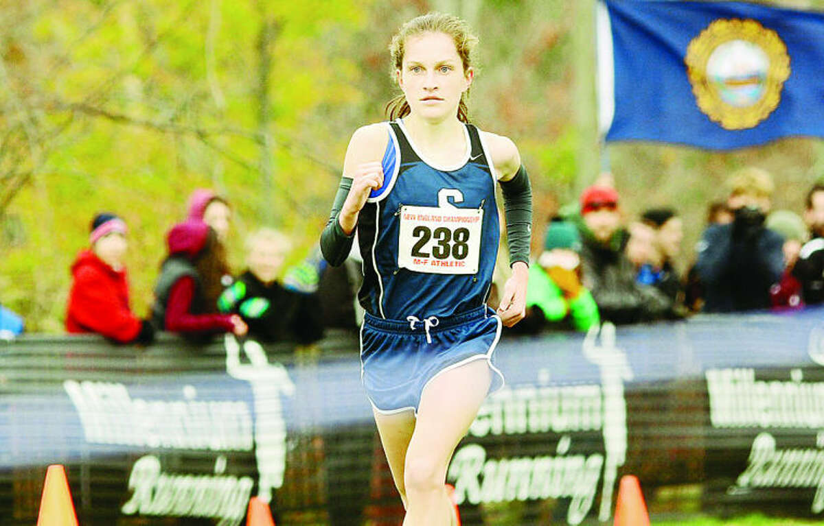 11/9/13 Hannah Debalsi, from Staples Connecticut, wins the girls race at a possible record time, during the NHIAA Meet of Champions, held at Derryfield Park, on Saturday, in Manchester. Thomas Roy/Union Leader