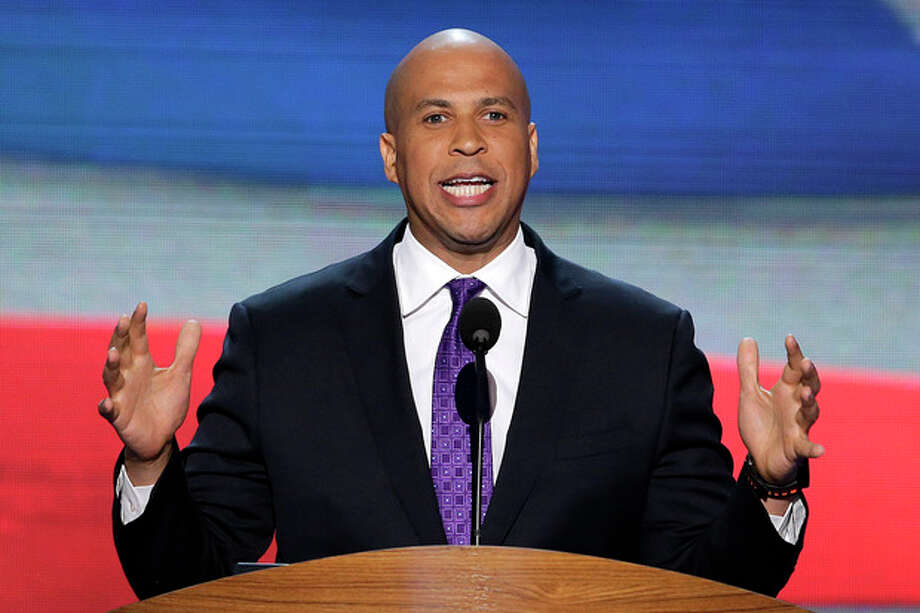 FILE - In this Sept. 4, 2012, file photo, Newark, N.J., Mayor Cory Booker addresses the Democratic National Convention in Charlotte, N.C. Booker, the Democratic former mayor of Newark, N.J., came into Congress as the rare freshman senator with celebrity status; even Oprah Winfrey calls herself a fan. During his first week in the Senate, Booker has tried to balance immersing himself in his new job and standing out from his 99 colleagues. (AP Photo/J. Scott Applewhite, File) / AP
