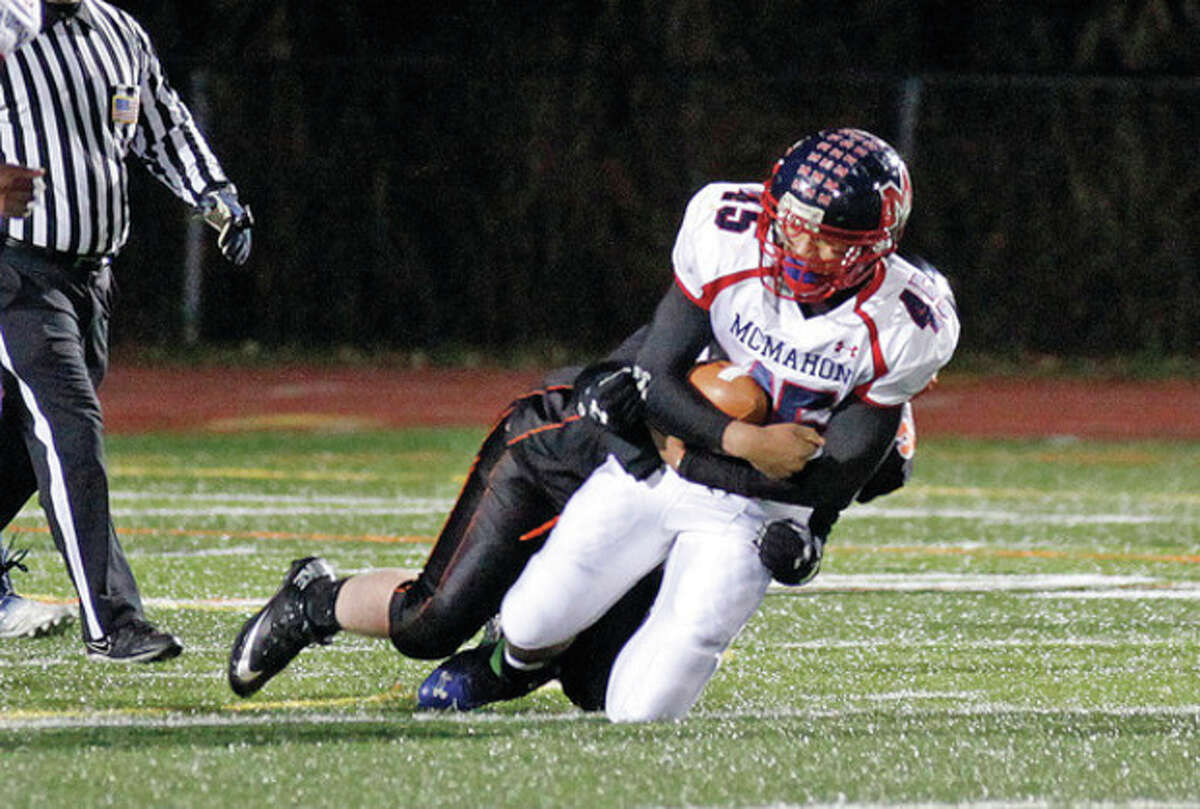 Hour Photo/Danielle Calloway Brien McMahon running back Kenny Keen gets tackled during a game against Ridgefield at Tiger Hollow Stadium Friday evening. The Senators suffered a 44-7 loss at the hands of the Tigers.