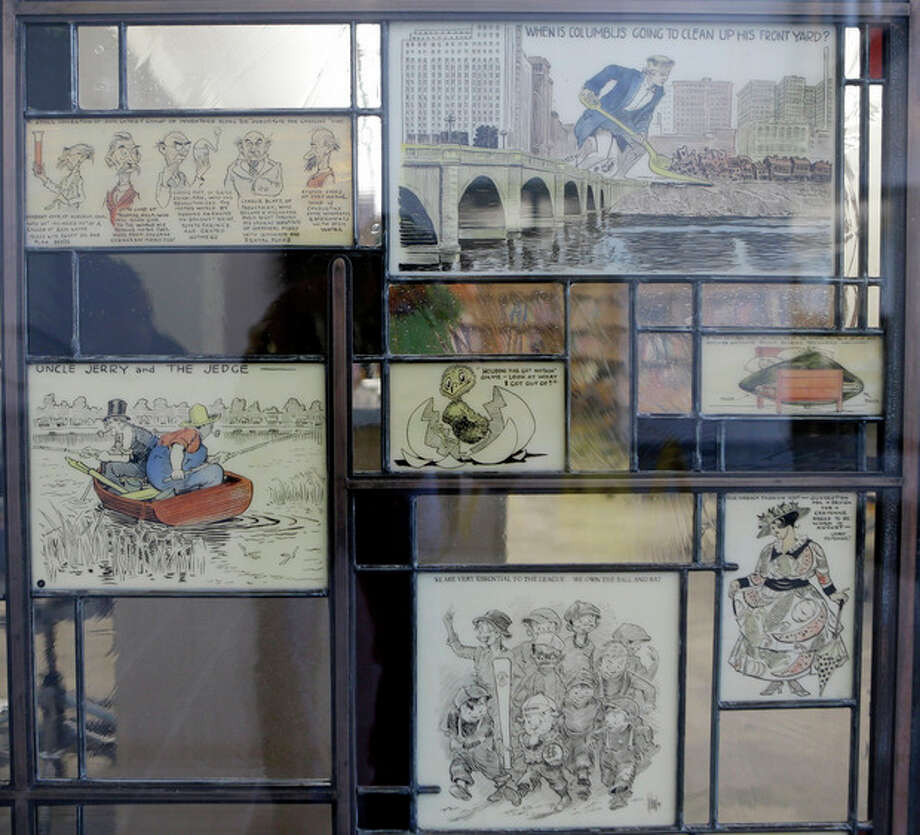 "In this Wednesday, Oct. 23, 2013 photo shows stained glass pieces from ""The Passing Show"" at the Billy Ireland Cartoon Library & Museum in Columbus, Ohio. Today the museum collection includes more than 300,000 original strips from everybody who's anybody in the newspaper comics world, plus 45,000 books, 29,000 comic books and 2,400 boxes of manuscript material, correspondence and other personal papers from artists. (AP Photo/Tony Dejak) / AP"