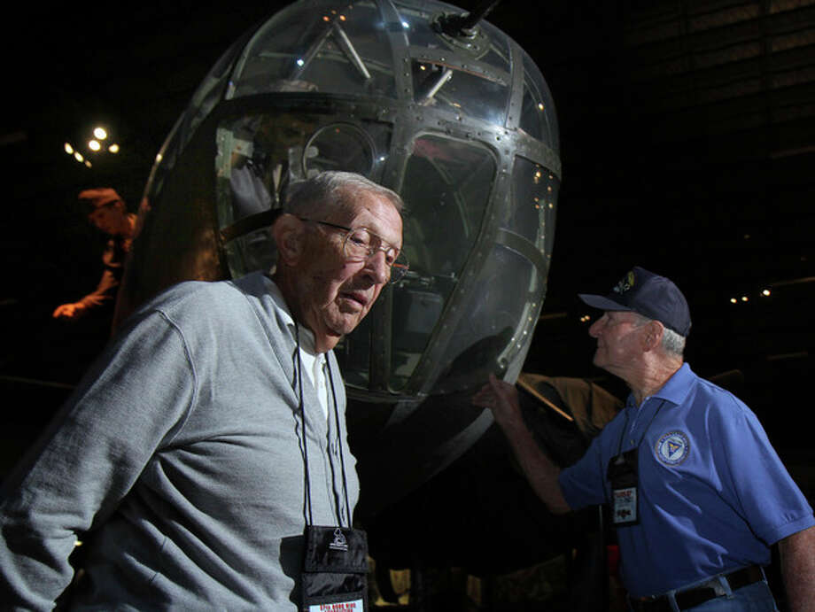 In this Sept. 27, 2013 photo, former B-25 pilot Paul Young and former crewman Bernie Peters, right, stand in front of a B-25 bomber in the U.S. Air Force Museum at Wright Patterson Air Force base in Dayton, Ohio during a reunion of the 57th Bomb Wing. When Young came home from the war, more than 70 years ago, there were 16 million veterans like him _ young soldiers, sailors and Marines who returned to work, raise families, build lives. (AP Photo/Tom Uhlman) / FR31154