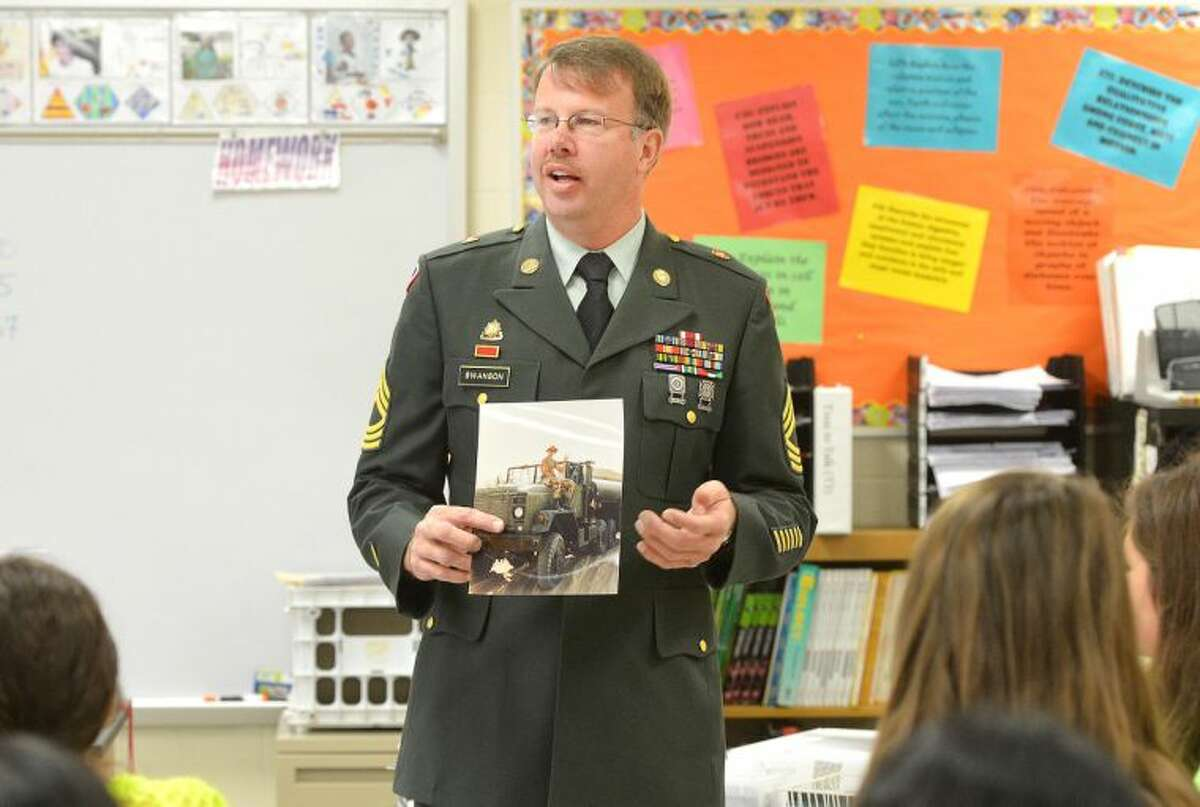 Hour Photo/Alex von Kleydorff . Master Sergeant Kraig Swanson talks about his tour of duty with the U.S. Army during Desert Storm during a Veterans Day Program at Nathan Hale School in Norwalk