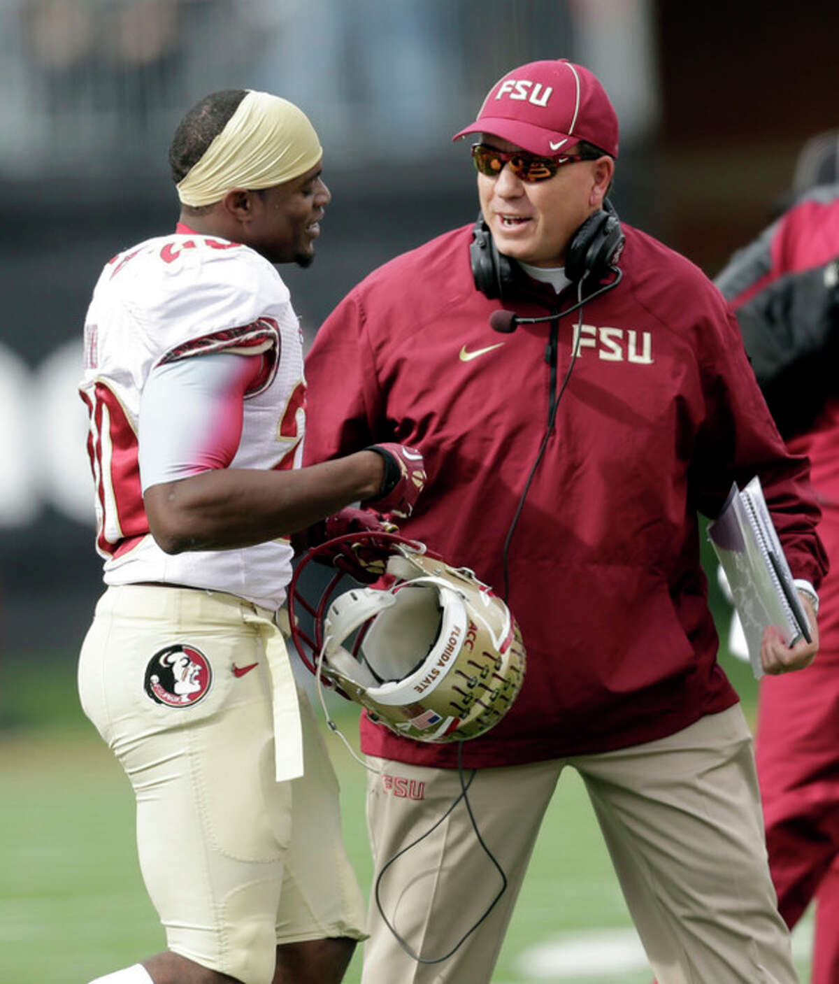 Florida State head coach Jimbo Fisher, right, talks to defensive back Lamarcus Joyner as his they play Wake Forest in the second half of an NCAA college football game in Winston-Salem, N.C., Saturday, Nov. 9, 2013. Florida State won 59-3. (AP Photo/Nell Redmond)