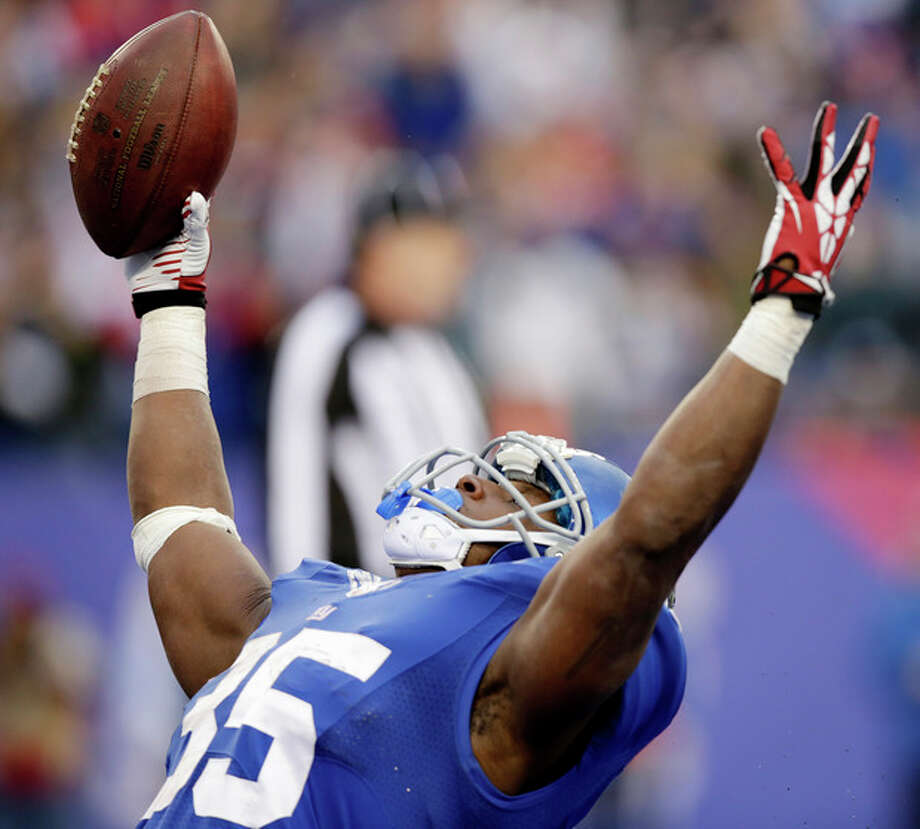 New York Giants running back Andre Brown celebrates after scoring a touchdown against the Oakland Raiders during the second half of an NFL football game, Sunday, Nov. 10, 2013, in East Rutherford, N.J. (AP Photo/Kathy Willens) / AP