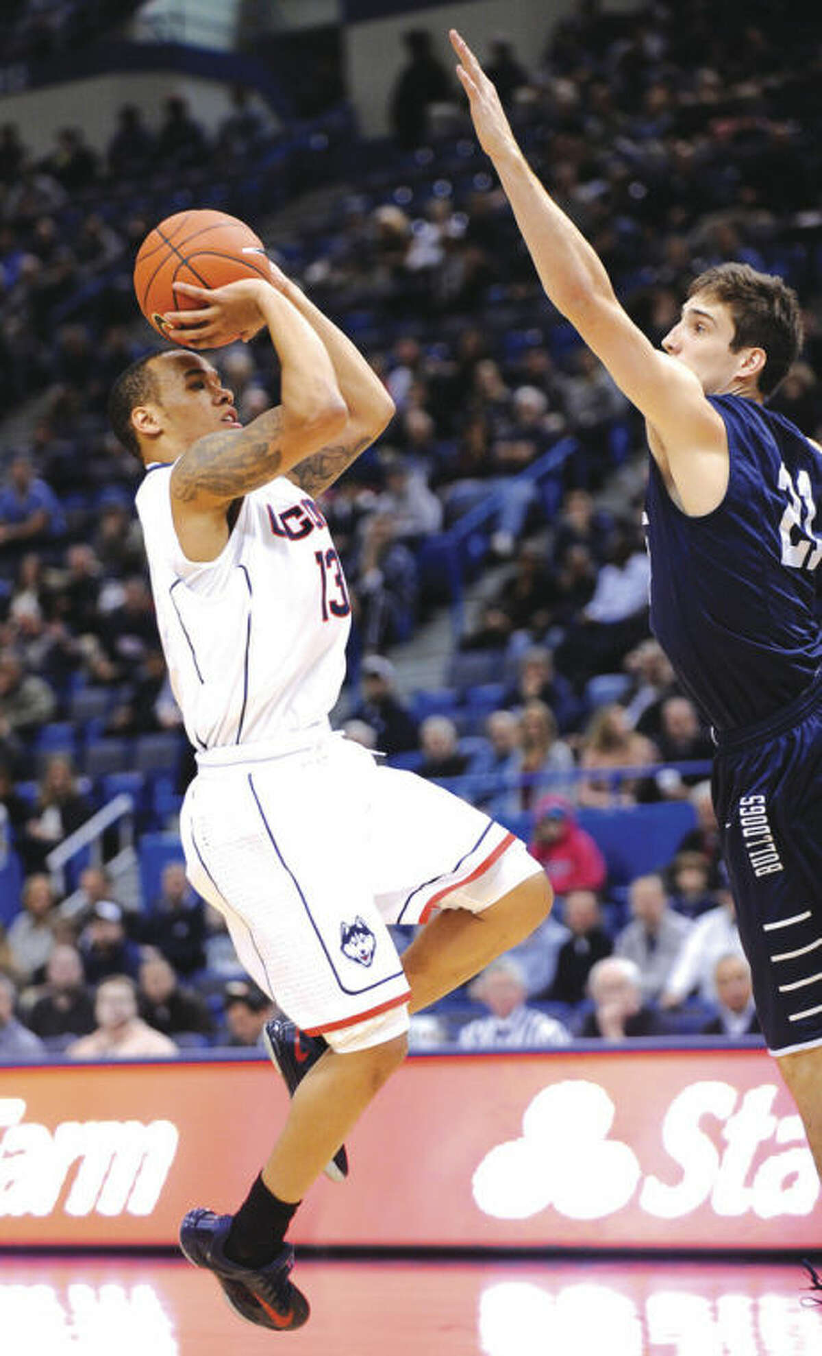 AP photo UConn's Shabazz Napier, left, shoots over Nick Victor of Yale during Monday afternoon's game at the XL Center in Hartford. Napier had the 10th triple-double in UConn history to lead the Huskies to an 80-62 victory over the Bulldogs.