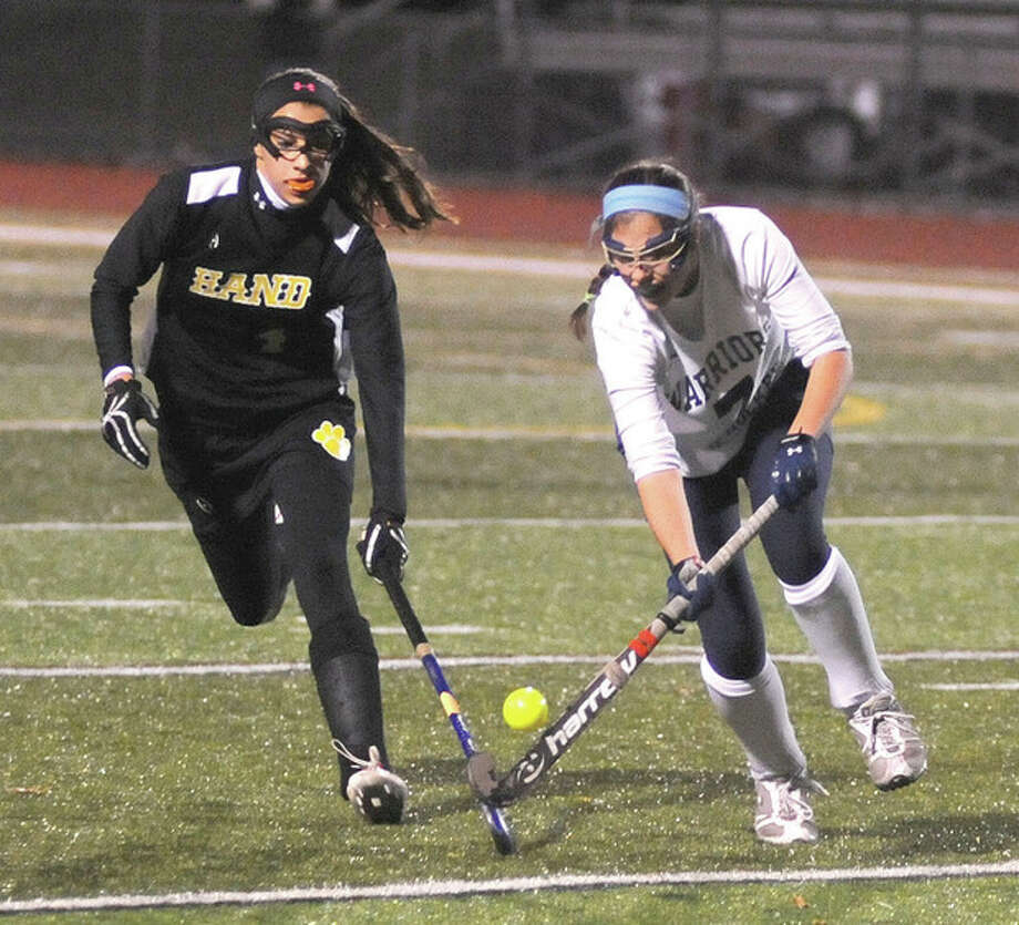 Hour photo/John NashAnnie Cornbooks of Wilton, right, gets to the ball ahead of a Daniel Hand player during Tuesday's Class M semifinal in Cheshire.