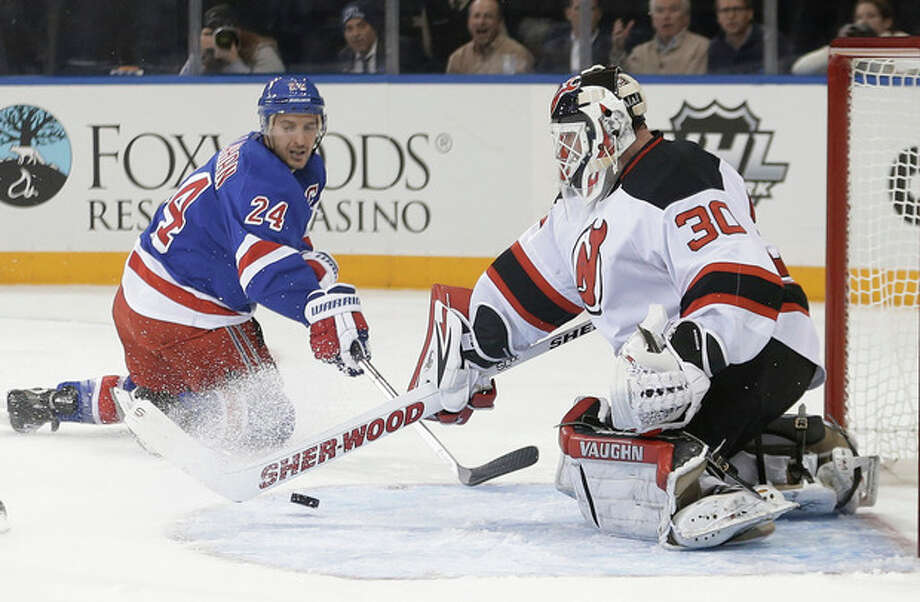 New Jersey Devils goalie Martin Brodeur (30) stops a shot by New York Rangers' Ryan Callahan (24) during the second period of an NHL hockey game Tuesday, Nov. 12, 2013, in New York. (AP Photo/Frank Franklin II) / AP