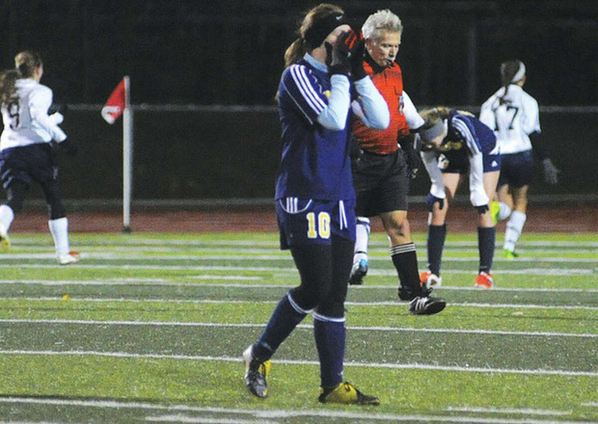 Hour photo/Matthew Vinci Weston's Jordan Isaacs buries her face in her hands after Haddam-Killingworth scored in the second half of Tuesday's Class M state semifinal game. H-K held on for a 1-0 win.
