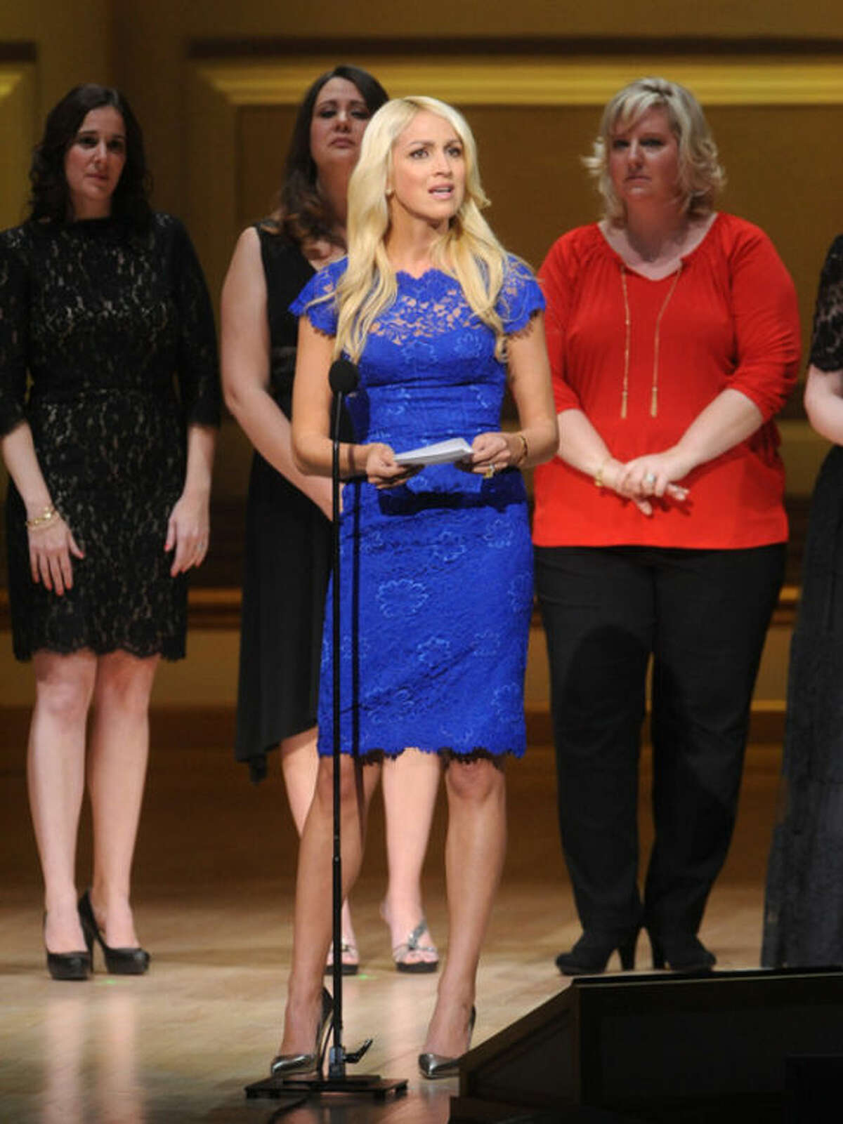 Sandy Hook Elementary School teacher Kaitlin Roig-Debellis accepts The Protector Award on stage at the 2013 Glamour Women of the Year Awards on on Monday, Nov. 11, 2013 in New York. (Photo by Brad Barket/Invision /AP Images)