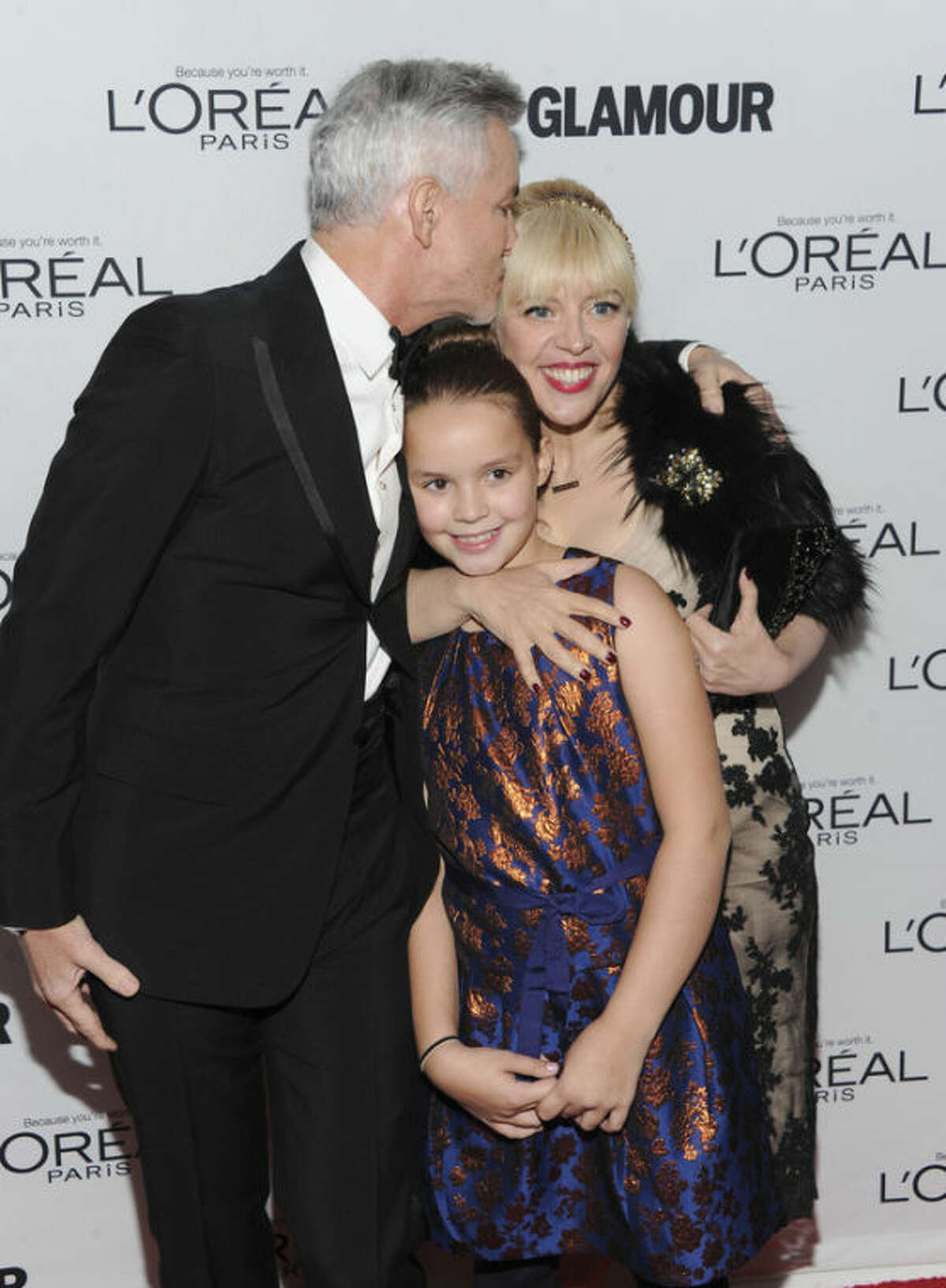 Honoree Catherine Martin and her husband, filmmaker Baz Lurhmann, and daughter Lillian attend the 23rd Annual Glamour Women of the Year Awards hosted by Glamour Magazine at Carnegie Hall on Monday, Nov. 11, 2013 in New York. (Photo by Evan Agostini/Invision/AP)