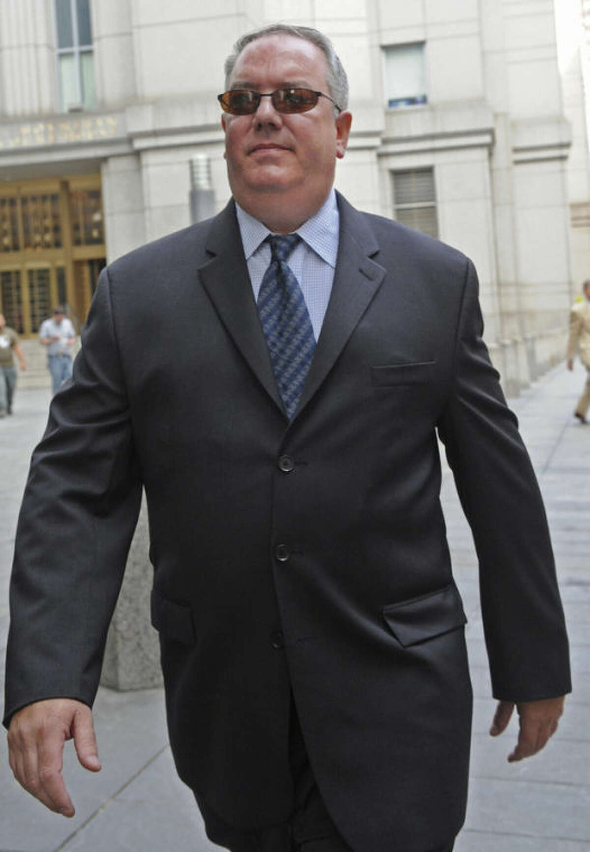 In this file photograph, Jerome O'Hara, former computer programmer for Bernard L. Madoff Investment Securities, leaves Manhattan federal court,Tuesday, June 21, 2011, in New York. O'Hara is accused of helping his former boss, Bernard Madoff, run a multibillion-dollar Ponzi scheme. (AP Photo/Louis Lanzano)