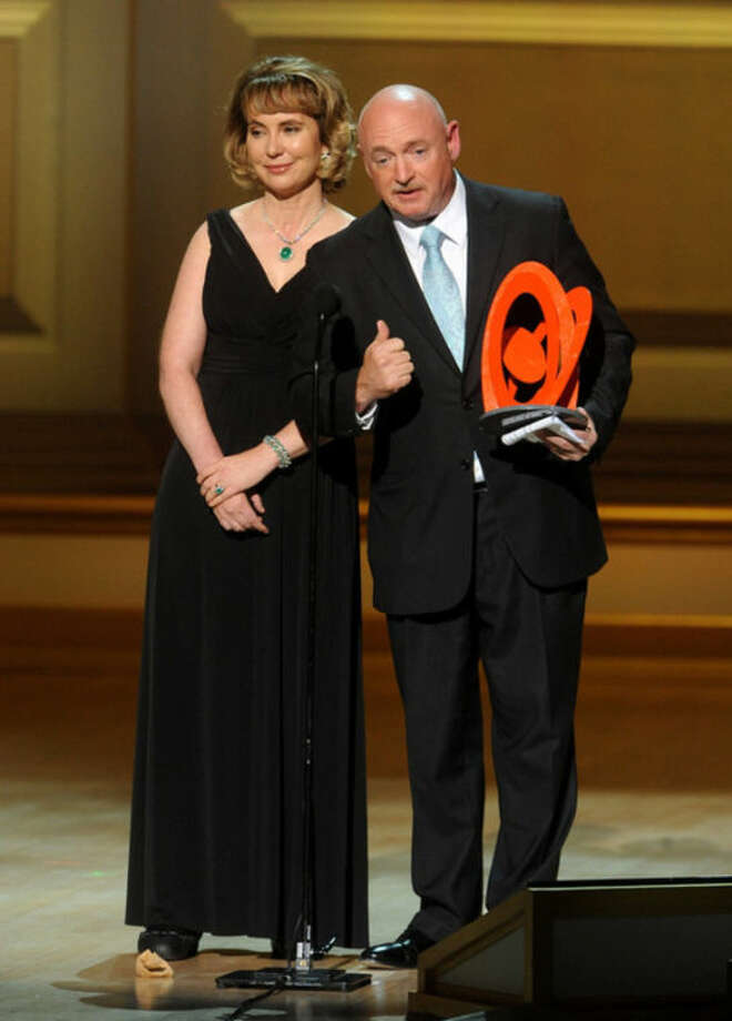 U.S. Representative Garbrielle Giffords, left, and husband Retired U.S. Navy Captain and NASA Astronaut Mark Kelly accept The Couple of the Year Award on stage at the 2013 Glamour Women of the Year Awards on on Monday, November, 11, 2013 in New York. (Photo by Brad Barket/Invision /AP Images)