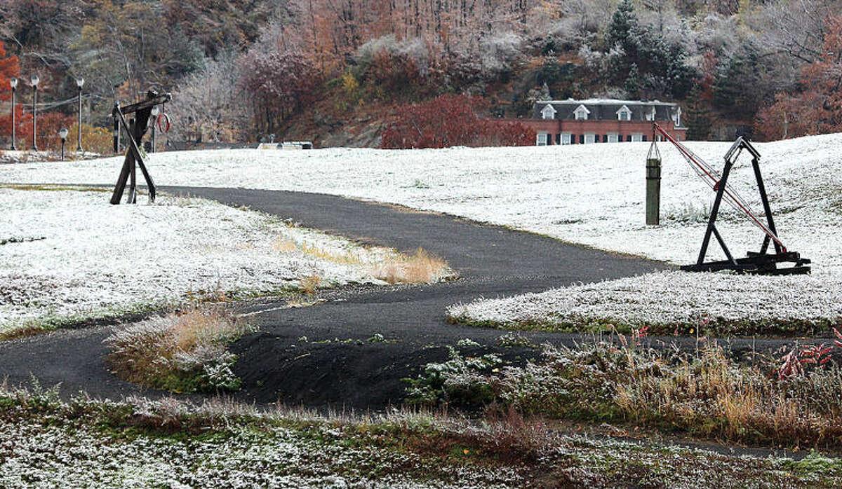 Hour photo / Chris Bosak The season's first snowfall coated the ground on Tuesday morning (11-12-13).