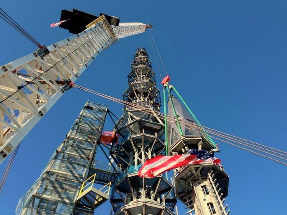 FILE - In this May 10, 2013 file photo, the silver spire topping 1 World Trade Center is fully installed on the building's roof, bringing the structure to its full, symbolic height of 1,776 feet in New York. The new World Trade Center tower in New York knocked Chicago's Willis Tower off its pedestal as the nation's tallest building when an international panel of architects announced Tuesday, Nov. 12, 2013 that the needle atop the skyscraper can be counted when measuring the structure's height. (AP Photo/Mark Lennihan) / ap