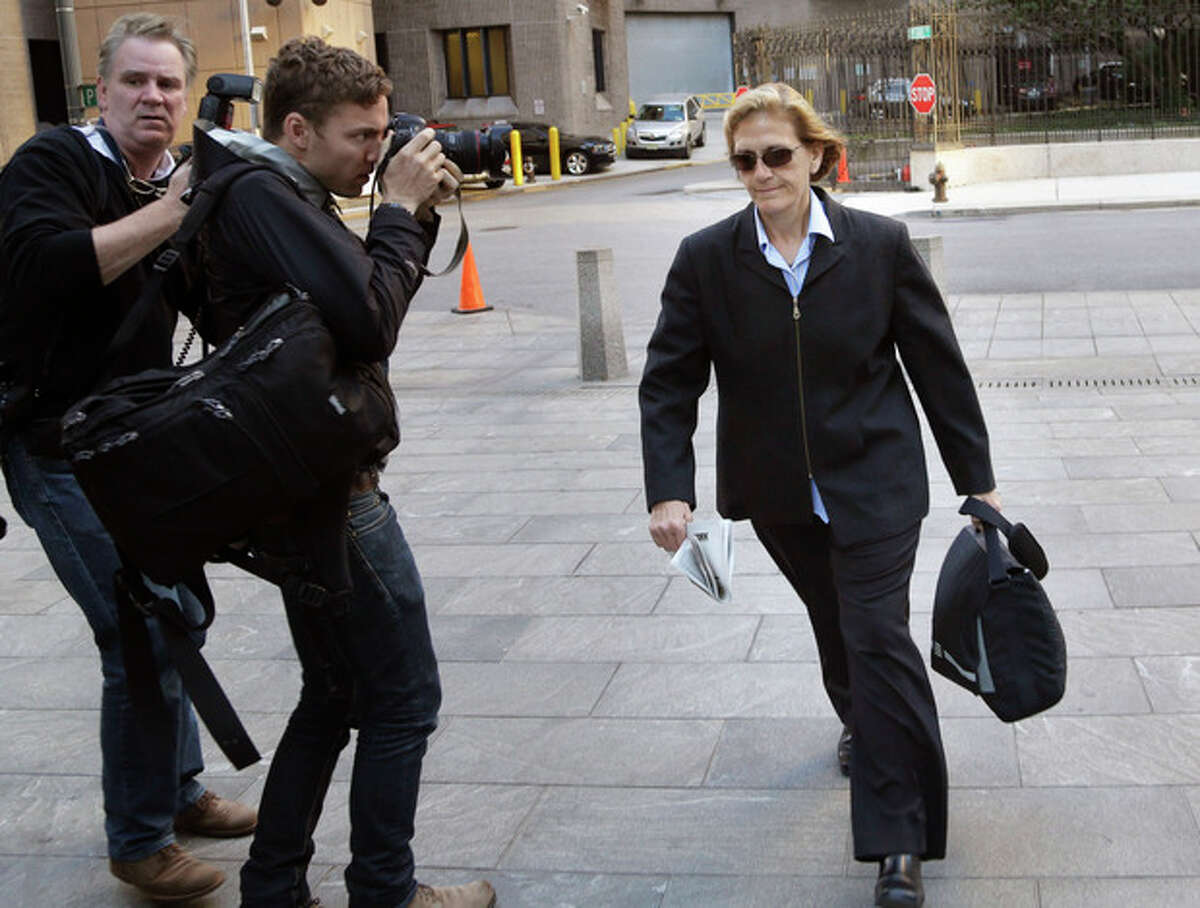 In this file photograph, JoAnn Crupi, right, arrives at federal court in New York, Tuesday, Oct. 8, 2013. Prosecutors say fictitious trades and phantom accounts were created with help from Crupi, an account manager. (AP Photo/Seth Wenig)