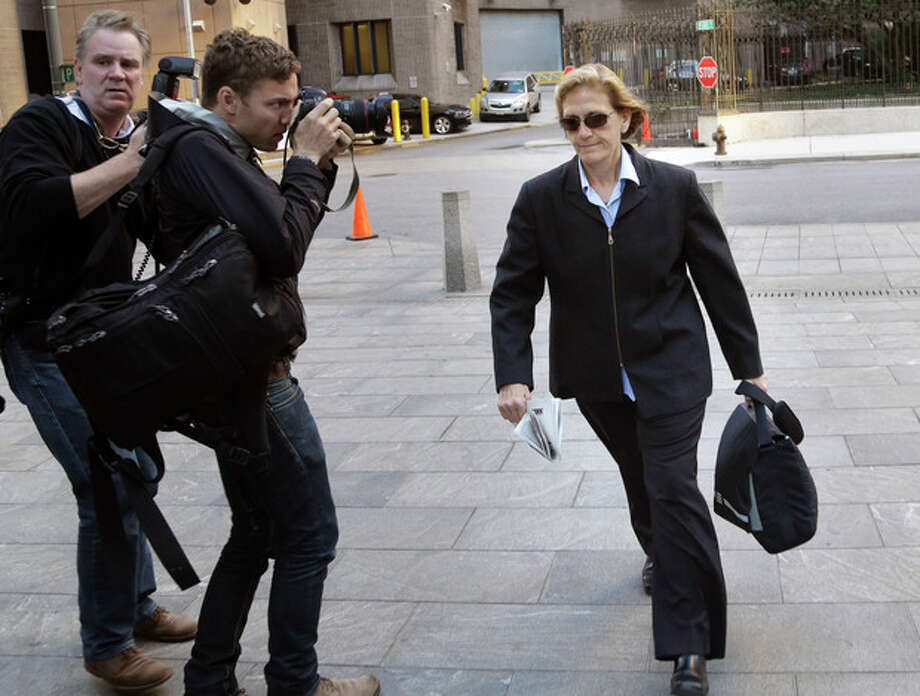 In this file photograph, JoAnn Crupi, right, arrives at federal court in New York, Tuesday, Oct. 8, 2013. Prosecutors say fictitious trades and phantom accounts were created with help from Crupi, an account manager. (AP Photo/Seth Wenig) / AP