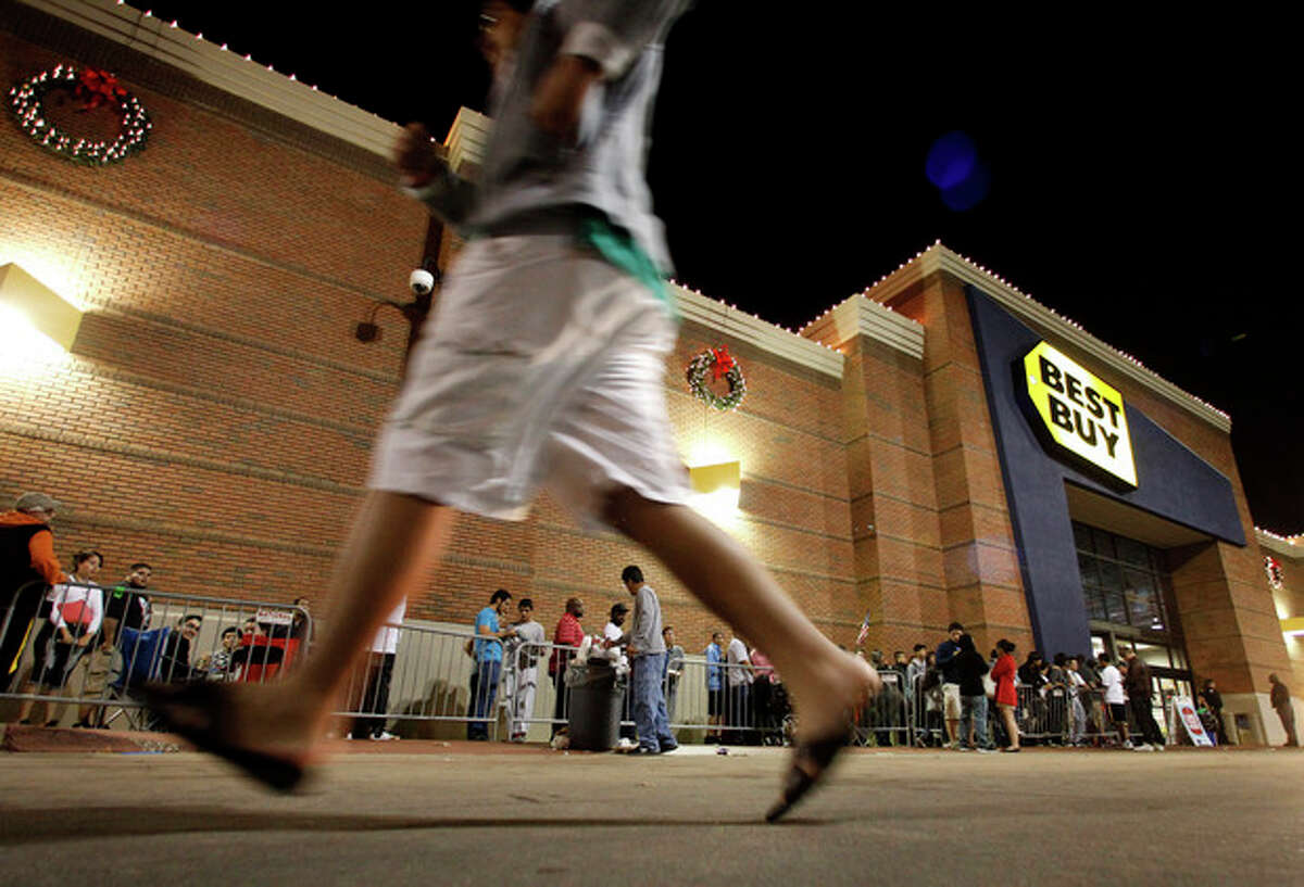 FILE - In this Thursday, Nov. 22, 2012, file photo, shoppers stand in line outside a Best Buy department store before the store's opening at midnight. Thanksgiving is slowly becoming just another shopping day as at least a dozen major retailers are planing to open Thursday, Nov. 28, 2013. (AP Photo/Tony Gutierrez, File)